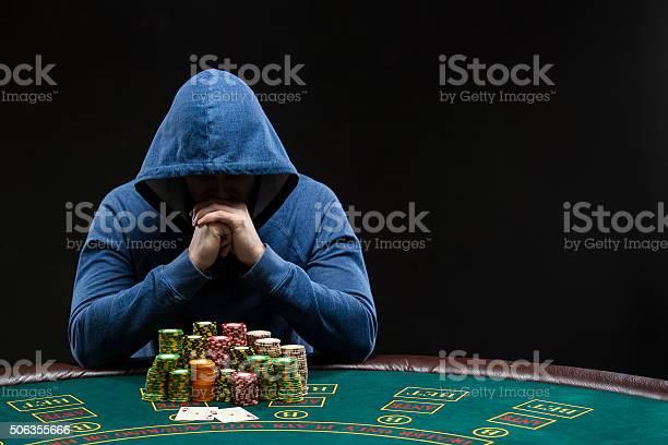 Poker player looking at combination of two aces closeup picture id506355666?b=1&k=6&m=506355666&s=612x612&h=v9ovjlarsu bar4k5  rpwjxhp0xprmrb8ksnj1w7za=