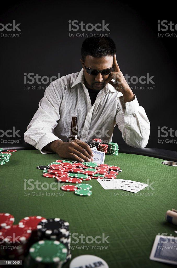 Poker player thinking royalty-free stock photo