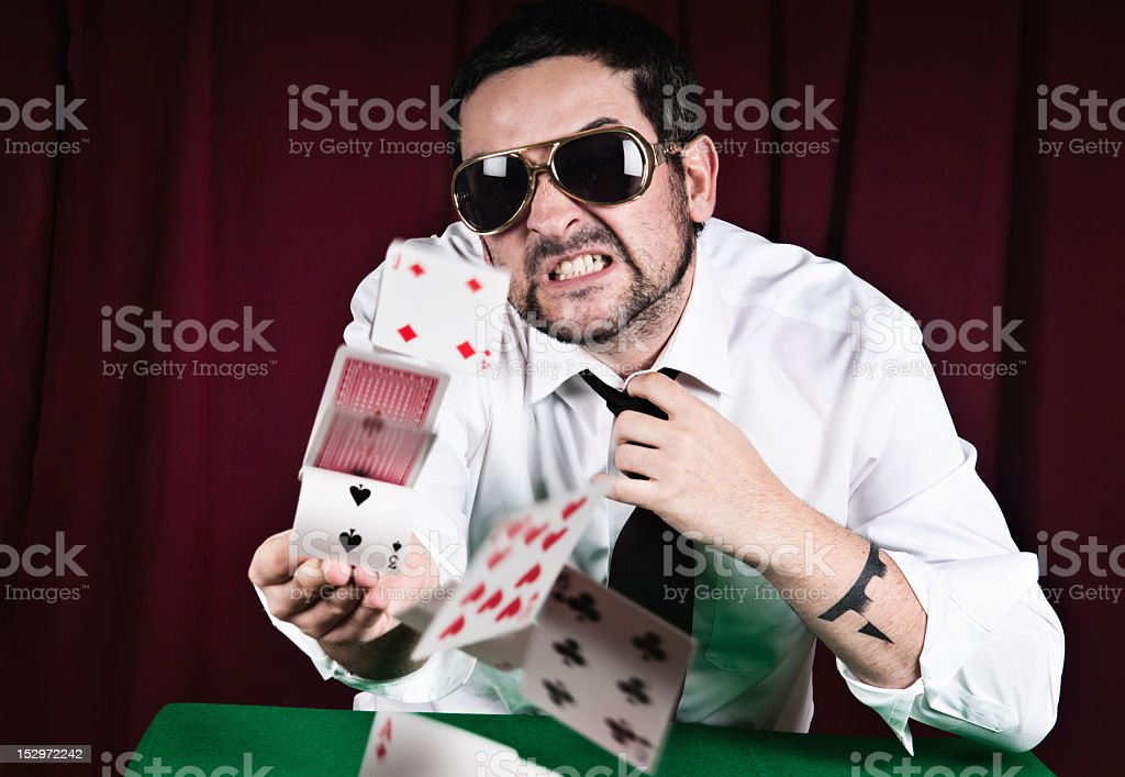 Poker player throwing cards with rage royalty-free stock photo