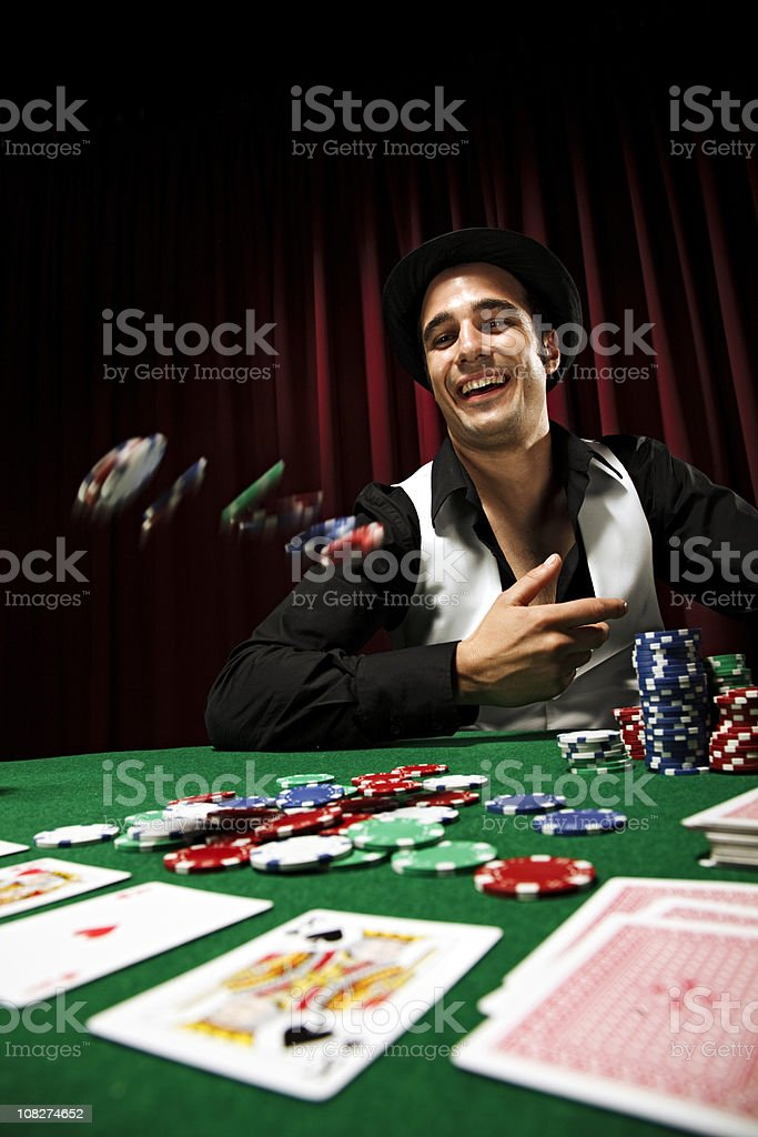 Poker player throwing chips at table royalty-free stock photo