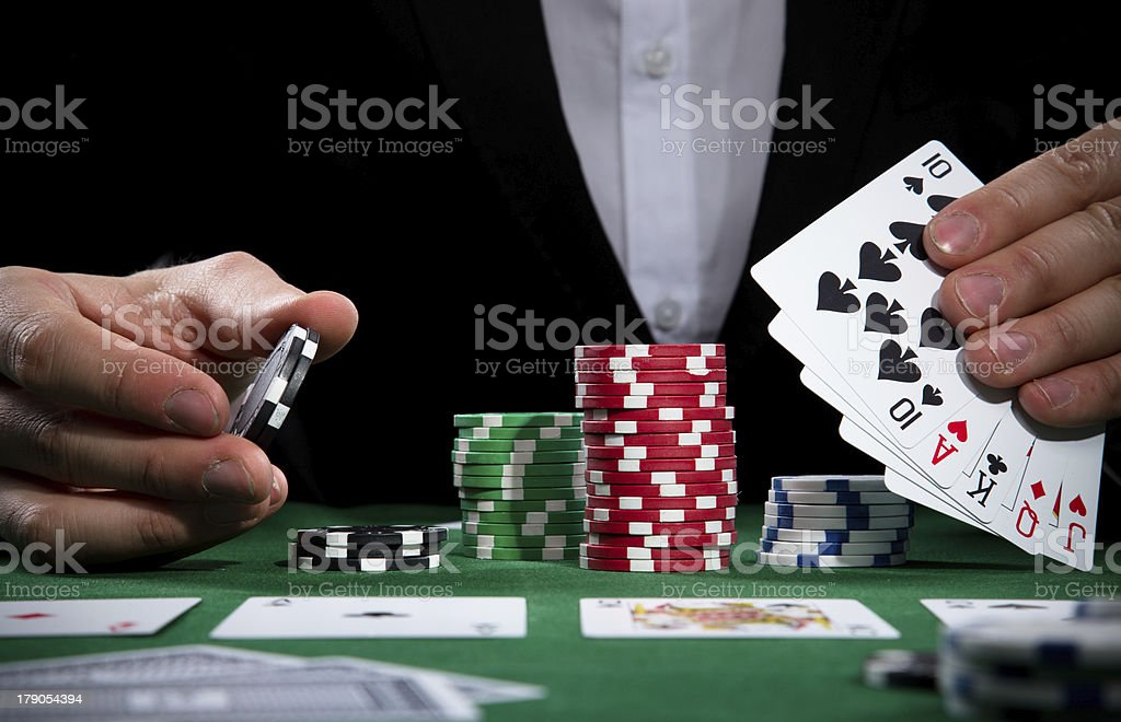 Poker player with chips and cards stock photo