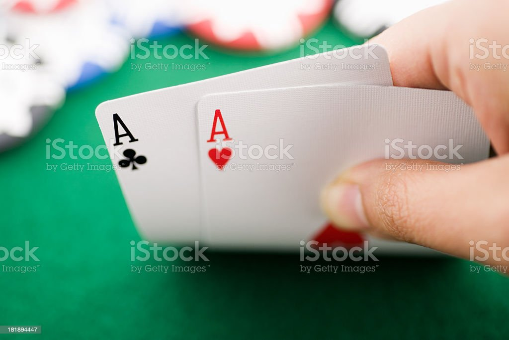Poker playing revealing pocket aces stock photo