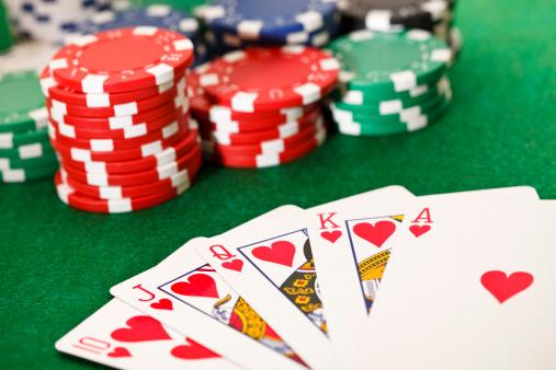 Poker, royal flush and gambling chips.