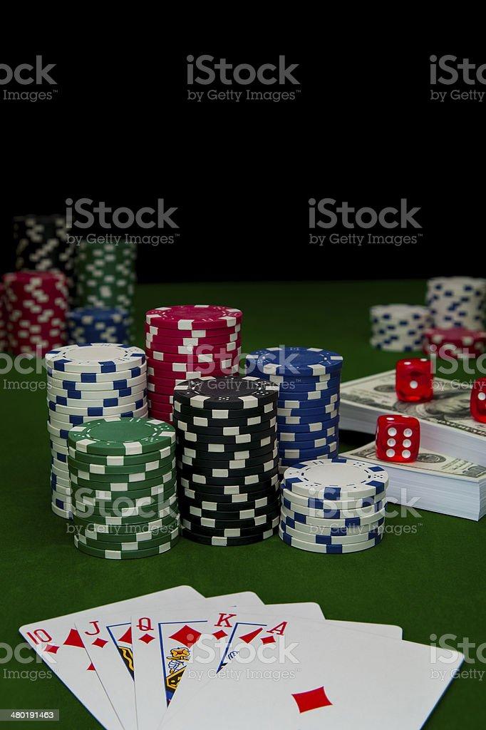 Poker, royal flush and gambling chips stock photo