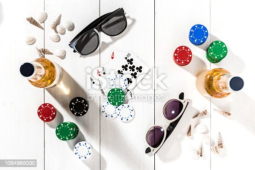 istock Poker. Set to playing poker with cards and chips on white wooden table, top view 1094965030