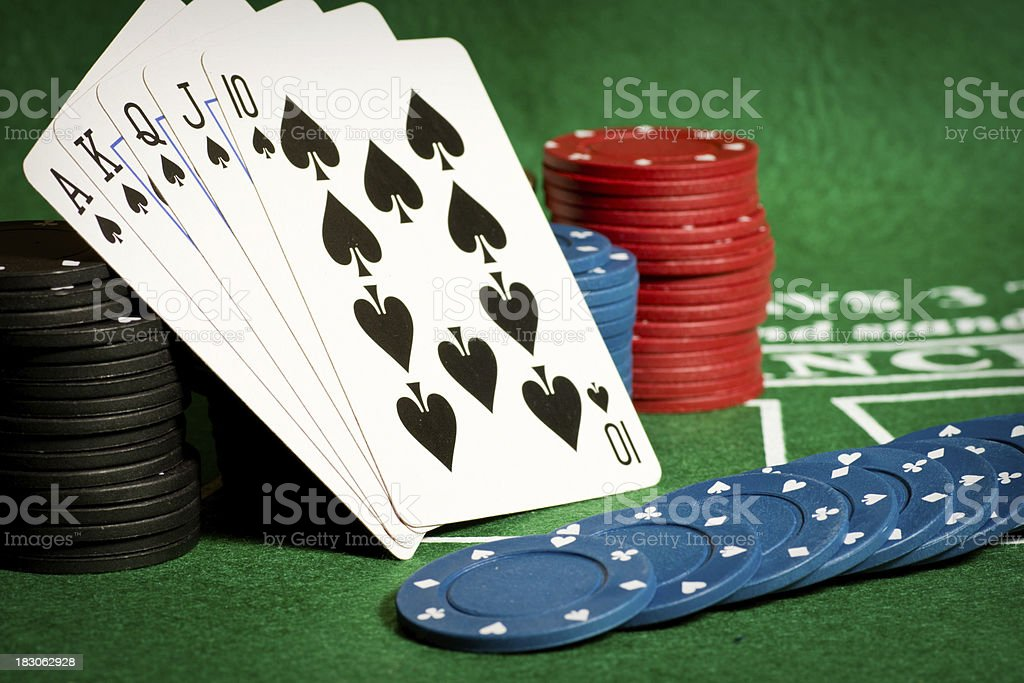 Poker table with gambling chips and cards royalty-free stock photo