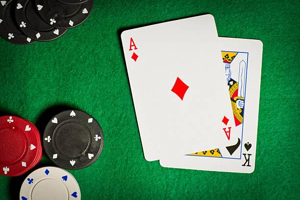 poker table with gambling chips and two cards - black jack bildbanksfoton och bilder