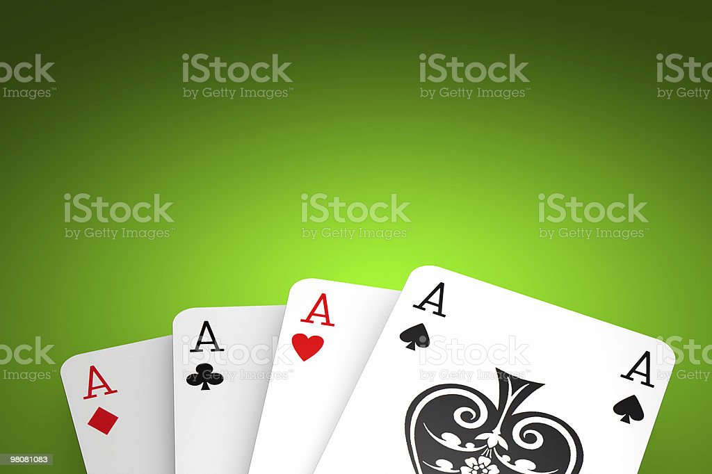 Poker winning hand over a green background. royalty-free stock photo