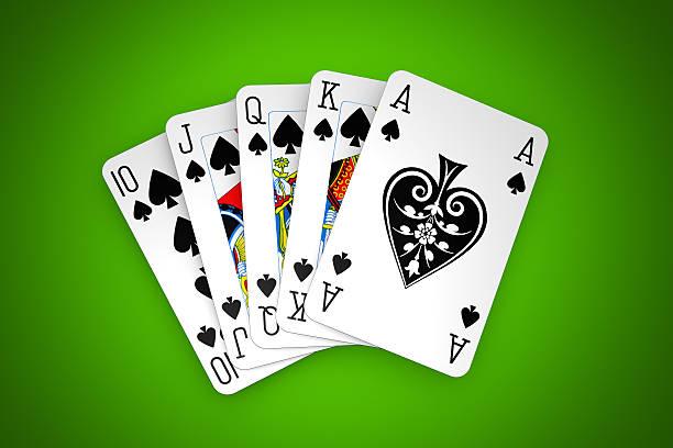 Poker winning hand over a vivid green background. stock photo