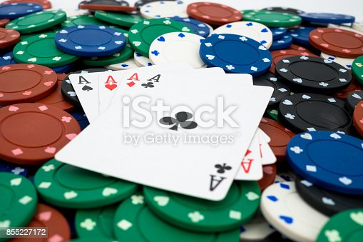 Pokerchips with good cards in black red blue green white