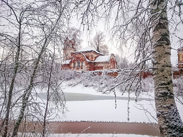 pokrov church of rekon'skaya hermitage monastery on frozen river bank - isvak bildbanksfoton och bilder