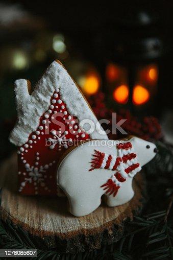 Homemade cookie in a polar bear shape isolated on black.