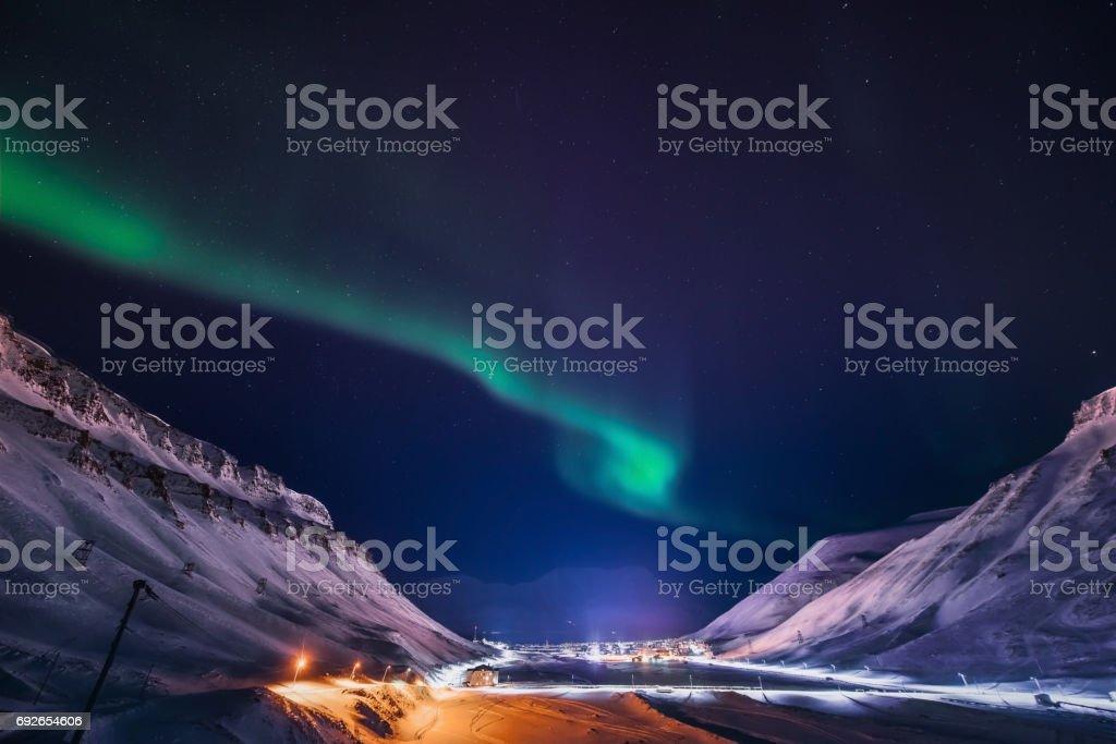 polar Northern lights in the mountains of Svalbard, Longyearbyen, Spitsbergen, Norway wallpaper stock photo