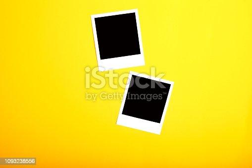 istock Polaroid Frames On Yellow Background 1093238556