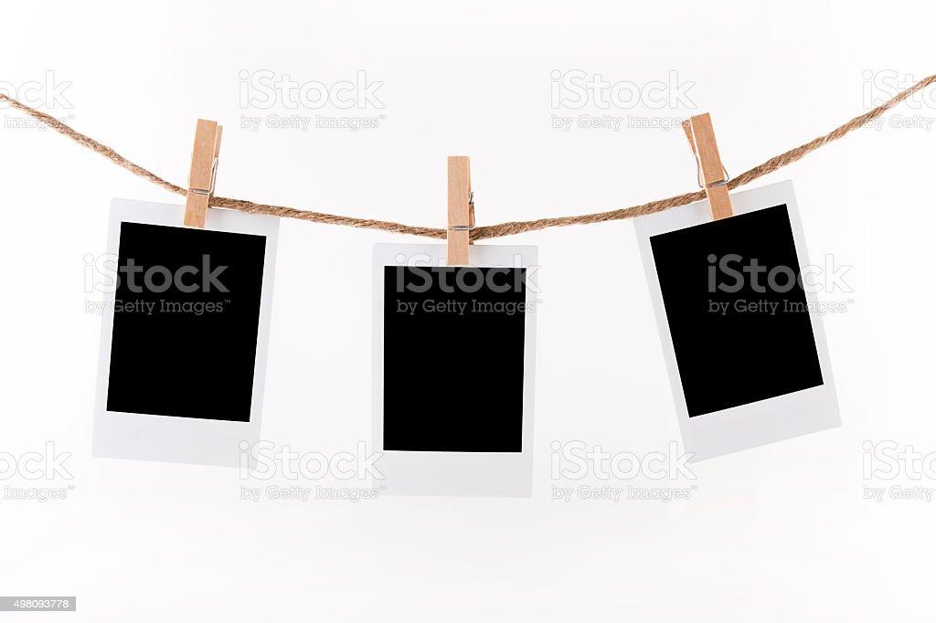 Polaroid Photo Frames on Rope. stock photo