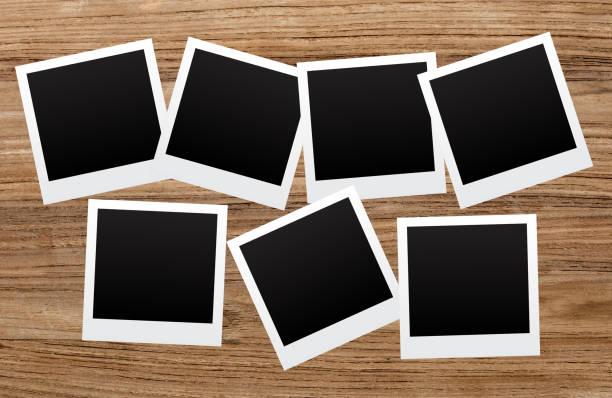 Polaroids on wooden background stock photo