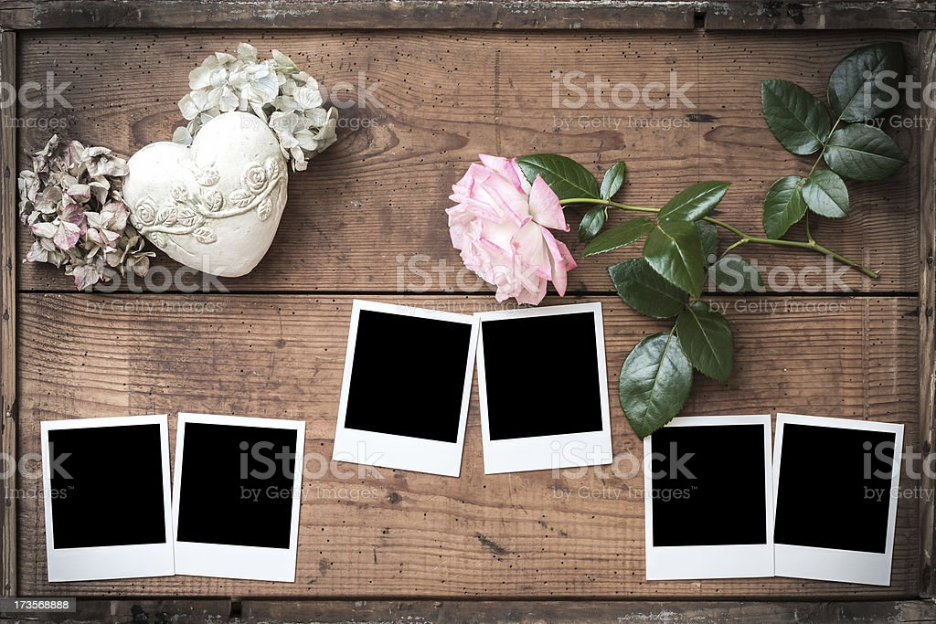 Polaroids on wooden boards with Rose and Heart stock photo