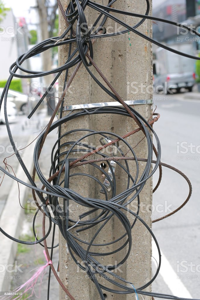 Pole and many the confused electric wires on it. stock photo