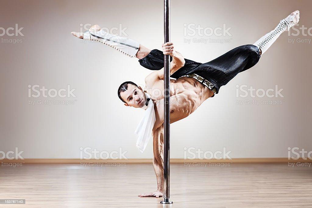 Pole dance man stock photo