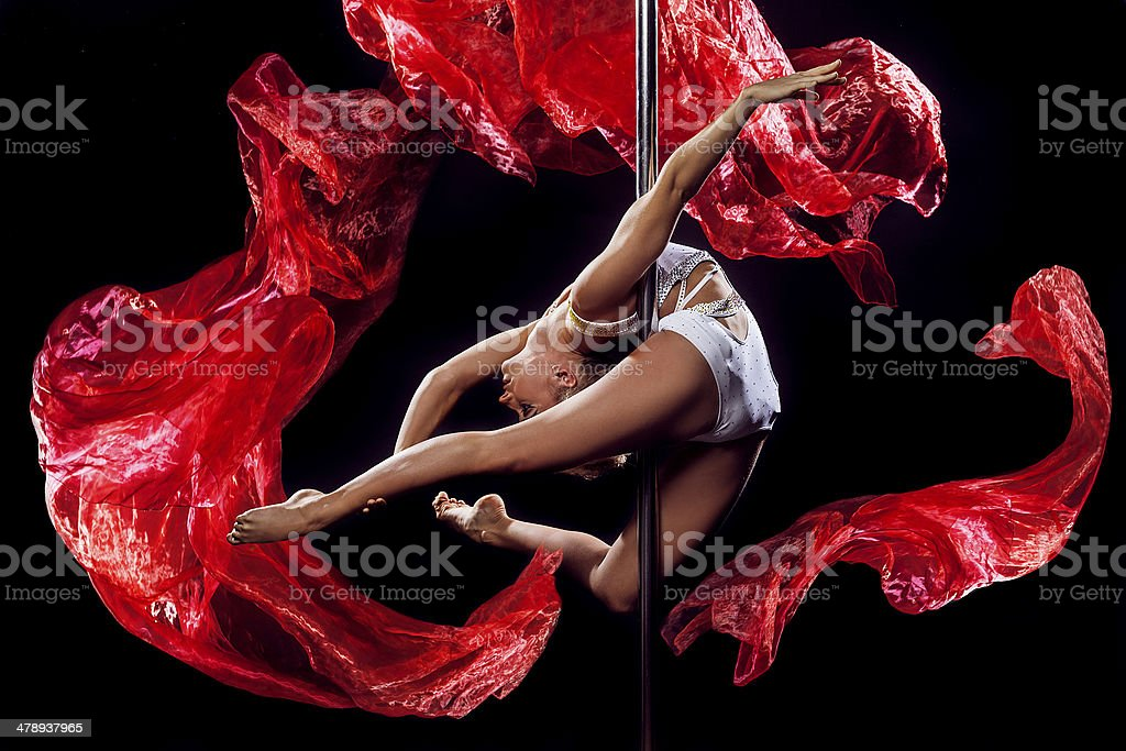Pole dance woman with red silks stock photo