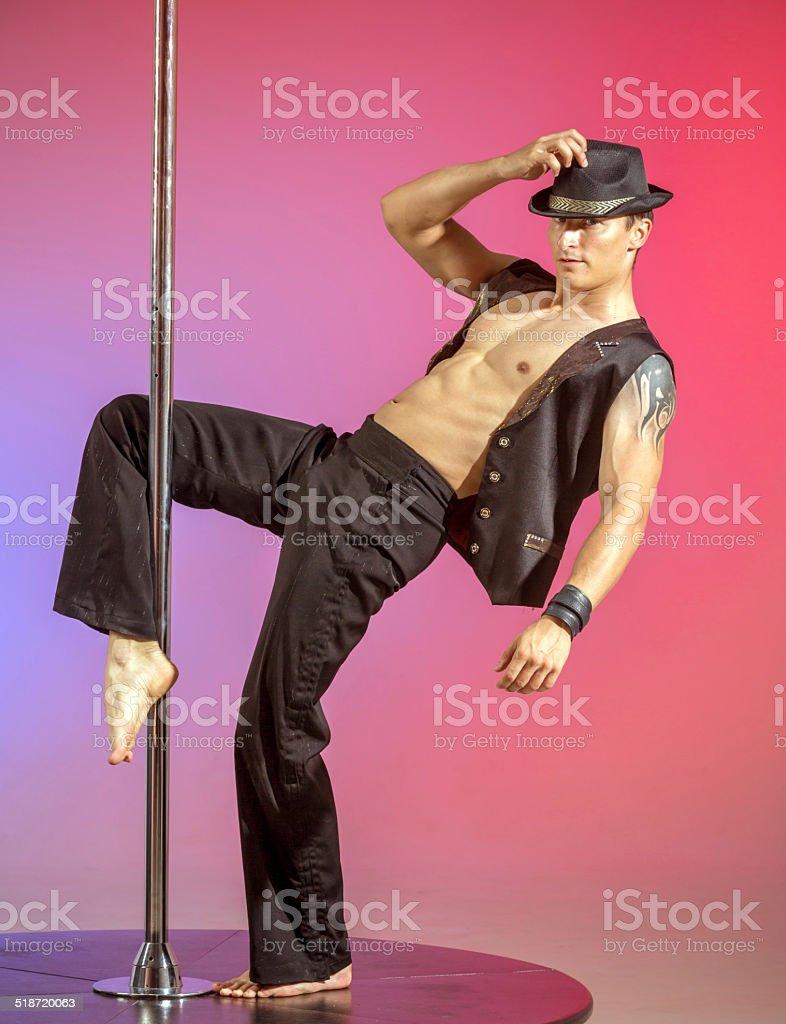 Pole dancer real man stock photo