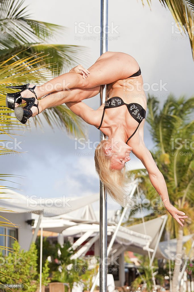 Pole dancing on the beach - hip hold royalty-free stock photo