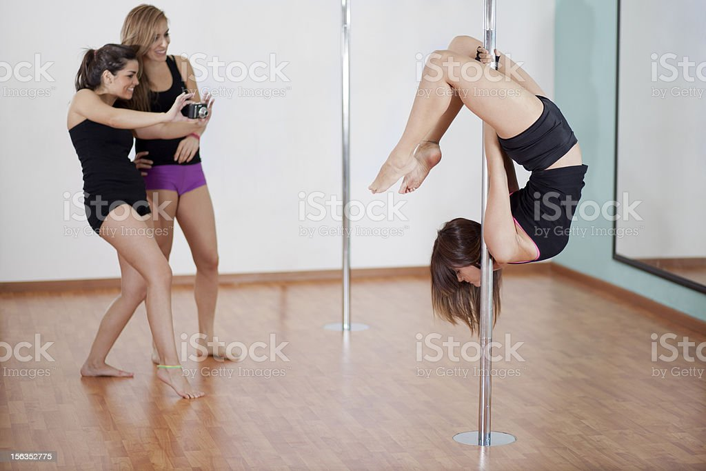 Pole fitness instructor during a demonstration royalty-free stock photo