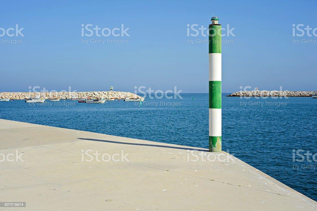 Pole on the pier stock photo