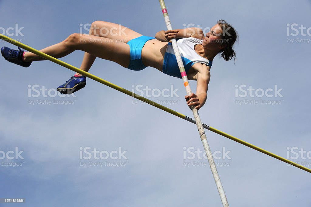 Pole vault action stock photo