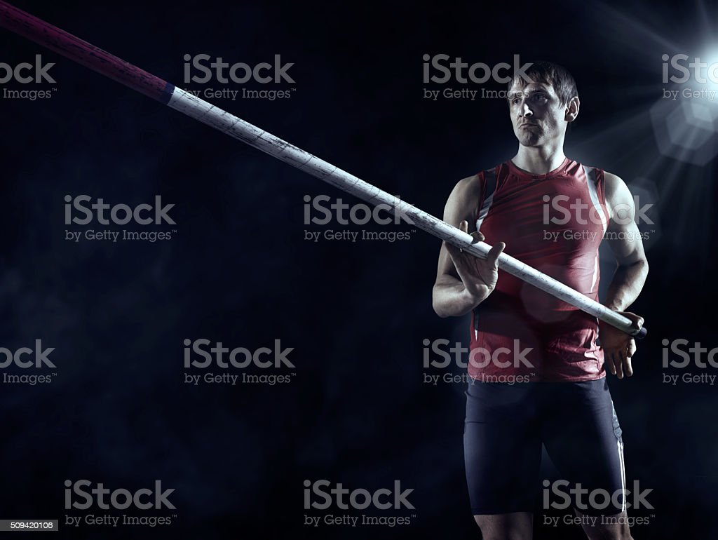 Pole vault athlete stock photo