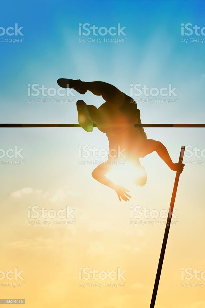 Pole vault back light stock photo