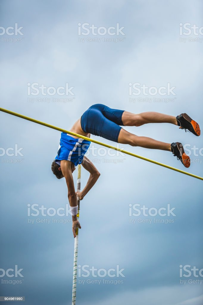 Pole vault male athlete competition stock photo