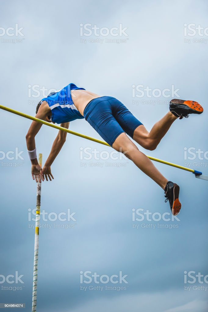 Pole vault man athlete attempt over bar stock photo