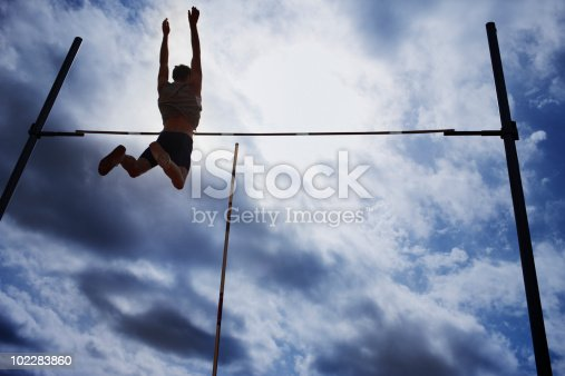 istock Pole vaulter in mid-air 102283860