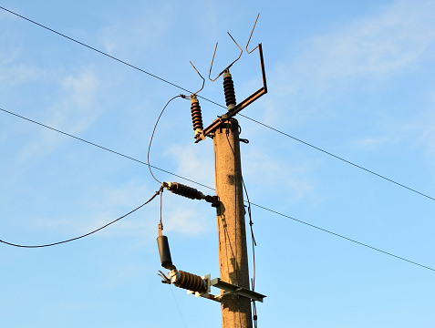 A pole with electrical wires. High-voltage power lines.