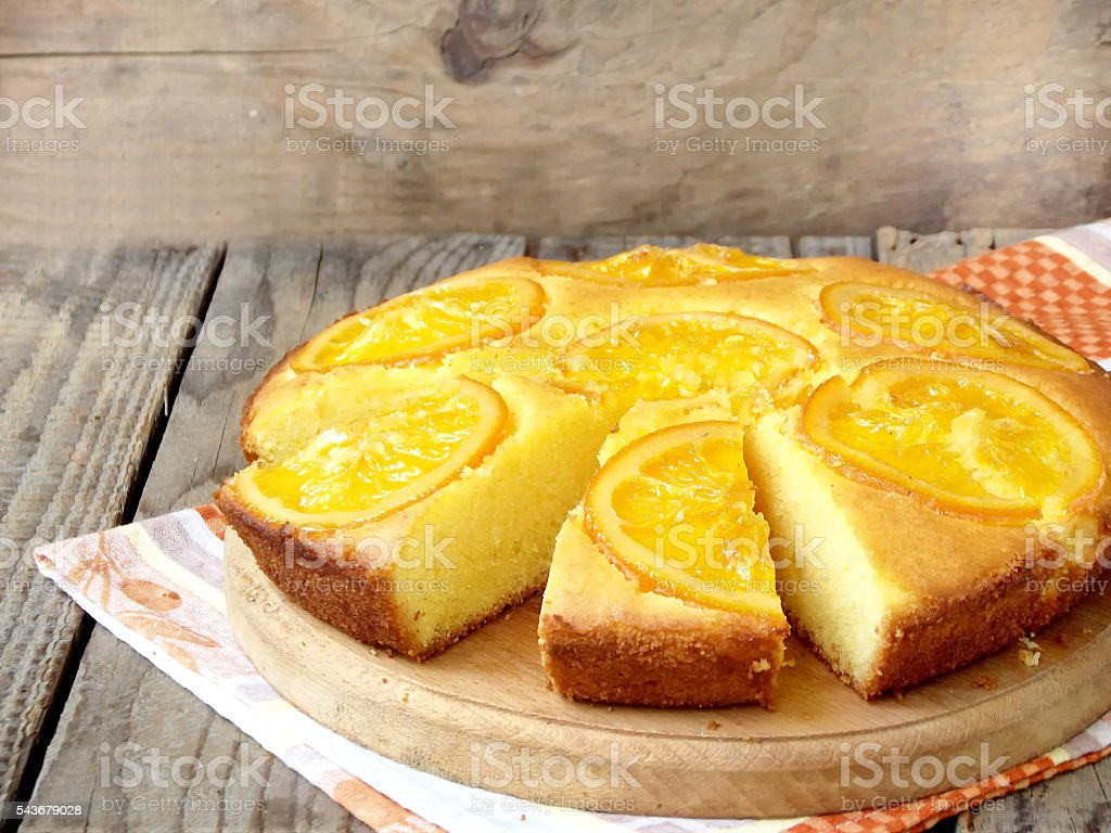 Polenta and orange butter cake on a wooden table. stock photo