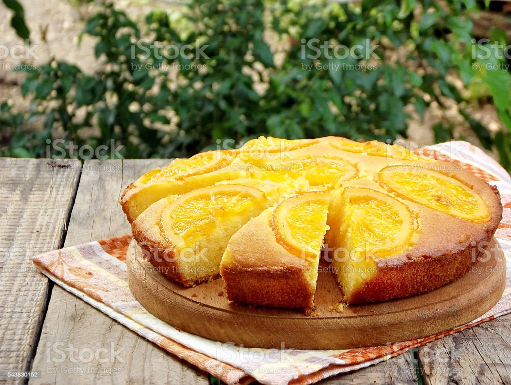 Polenta and orange butter cake on a wooden table. - foto de acervo