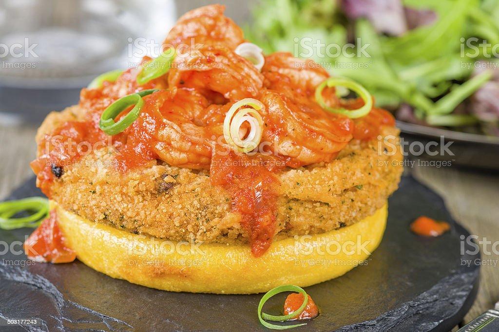 Polenta, Fishcake & Spicy Prawns stock photo