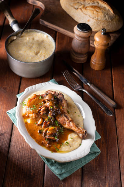 Polenta Pork Chops Pork Chops With Creamy Polenta with Balsamic Mushroom Ragout ragout stock pictures, royalty-free photos & images