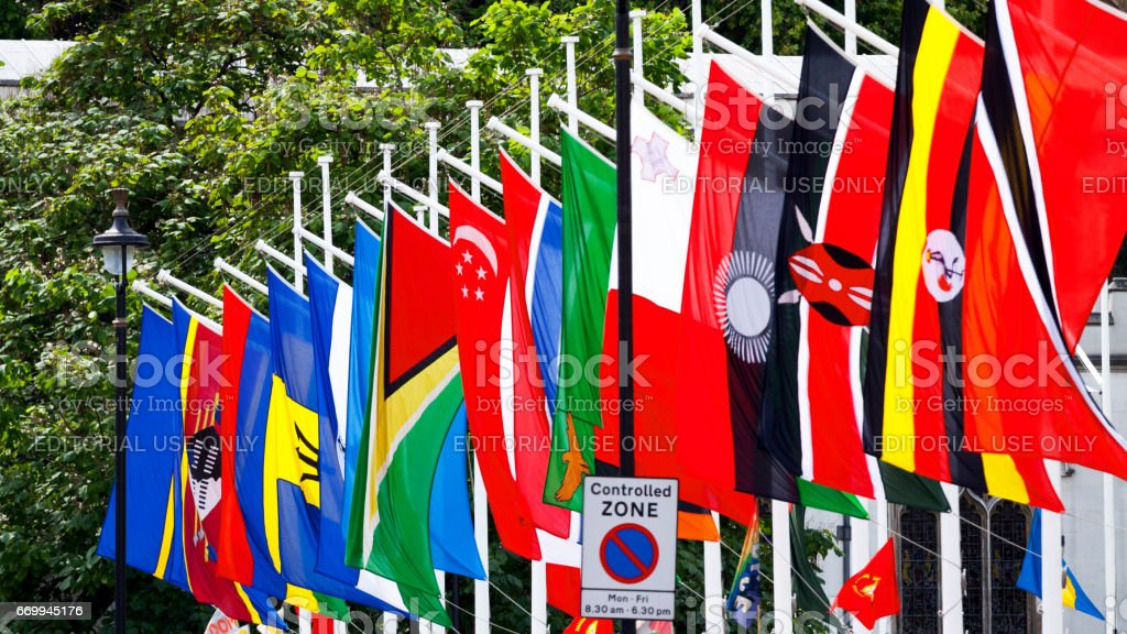 Poles with member flags of Commonwealth stock photo