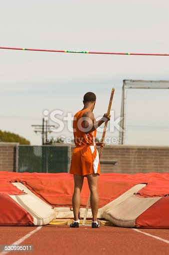 Pole-vaulter preparing for jump