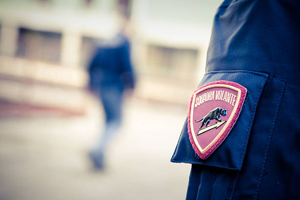 Police activity Padua, Italy - November 29, 2015: Policemen in activity during an operation in abandoned urban complex. The black panther on the shoulder of the policeman  is the symbol of the Italian Flying squad. university of wisconsin milwaukee stock pictures, royalty-free photos & images
