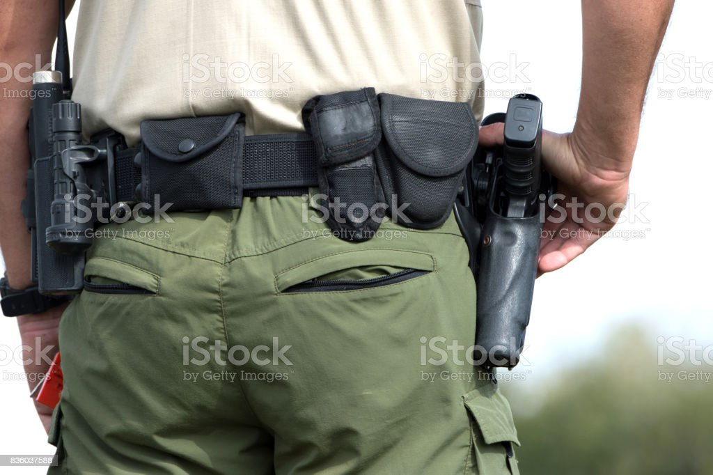 Police agent watching stock photo