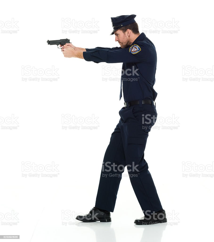 Police aiming with gun stock photo