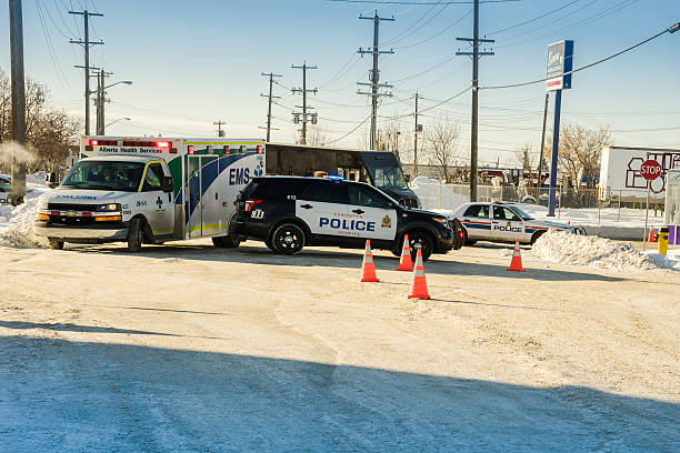 Police and ambulance on road accident scene stock photo