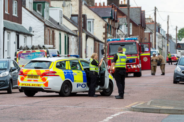 Police and fire brigade attending an incident stock photo