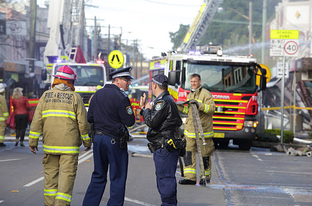 Police and Fire fighters attend blast explosion at shop stock photo