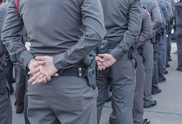 police and gun , working to prevent crime - oficial rango militar fotografías e imágenes de stock