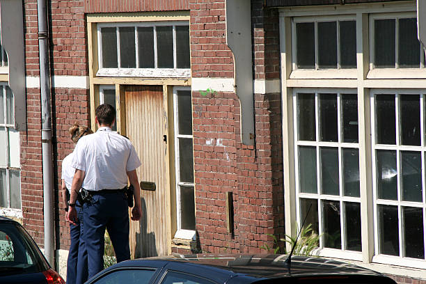 Police at the door stock photo