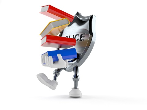 istock Police badge character carrying books 1043266780